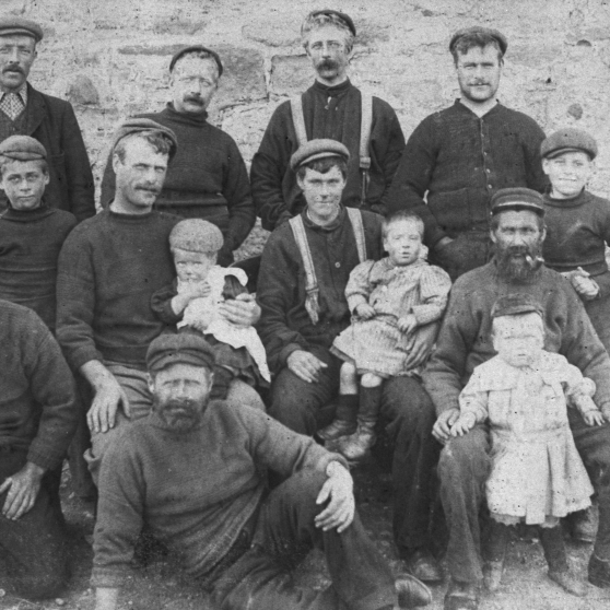 Group portrait of ten fishermen and their families, Cove, c.1900