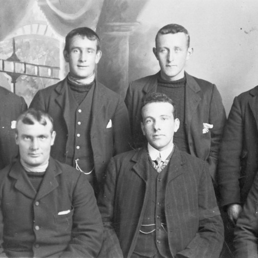 Group portrait of seven men, Yarmouth, 1909