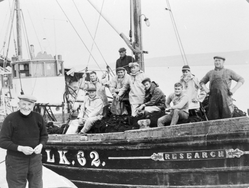 Crew of 'research' LK62 on last day of fishing. Skipper Robert Polson on pier.
