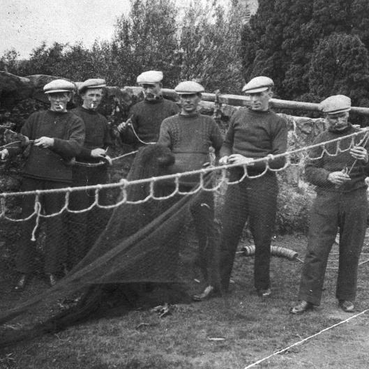Portrait of six fishermen setting up a ringnet, Tarbert