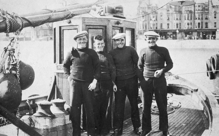 Portrait of Four Men Onboard 'Mystical Rose', CN245, Campbeltown, c.1937.