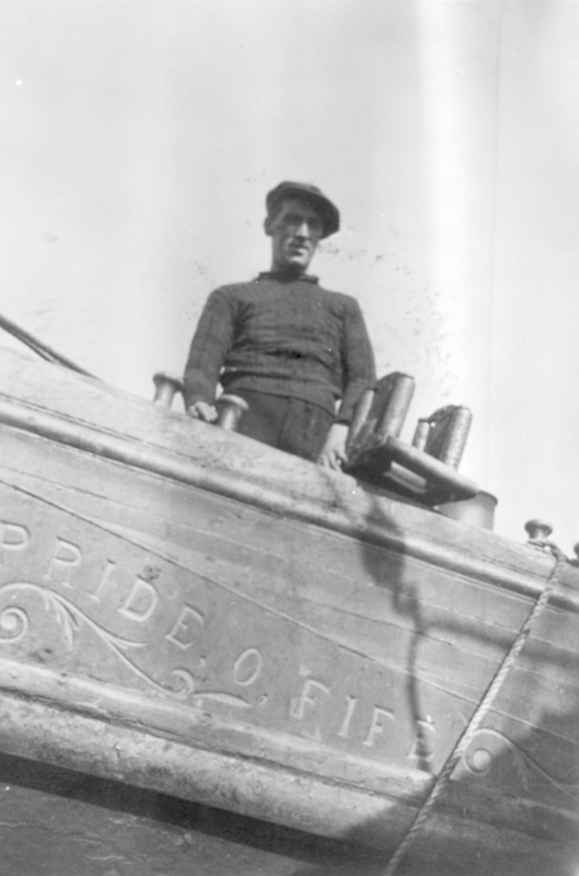 Crew member on board 'Pride O Fife', KY218. He is standing beside the 'messenger' rollers.