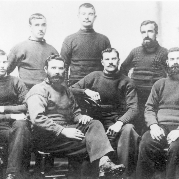 Studio portrait of the crew of 'Agenora', KY534. Buckhaven, 1895. Back row, L-R: James Thomson, James Taylor, WIlliam Thomson Front row, L-R: James Gordon, Thomas Thomson, Walter Foster, Robert Thomson. Robert Thomson was the owner of 'Agenora' and WIlliam Thomson was son of Andrew Thomson and father of Thomas 'Piper' Thomson.
