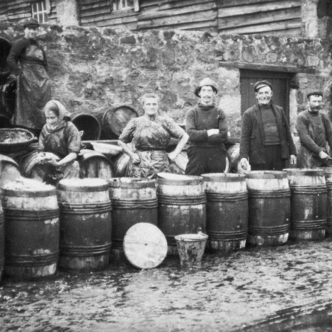 Group of men, women and children thought to be outside the present Scottish Fisheries Museum, 1909. The boy second from right is Wullie Jack. Jack later became a greengrocer, a profession he held for 35 years. He was father of Anita Jack and museum architect. It is believe this photograph was taken outside the museum at Harbour Head on the north side of the street.