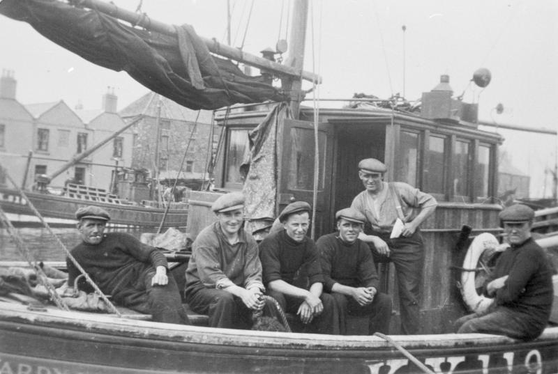 Crew on board 'Star of Hope', KY119. Taken at Eyemouth, 1939. L-R: Peter Boyter, David W. Allan, J. Stevenson, Tom Costorphine, David Costorphine, and Jock Brown. Skipper Tom Ovenstone is not present.