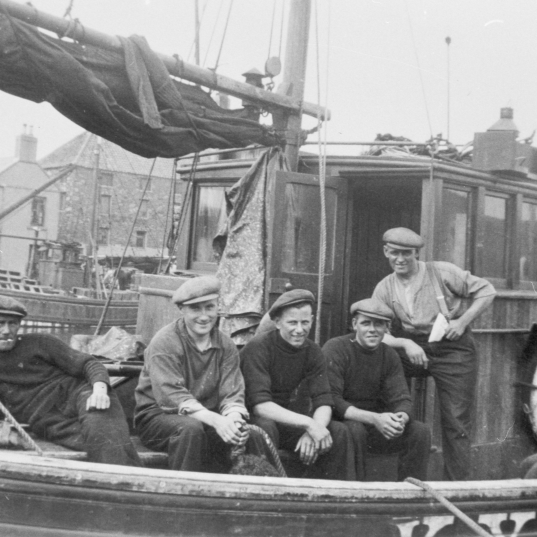Crew on board 'Star of Hope', KY119. Taken at Eyemouth, 1939. L-R: Peter Boyter, David W. Allan, J. Stevenson, Tom Costorphine, David Costorphine, and Jock Brown. Skipper Tom Ovenstone is not present.