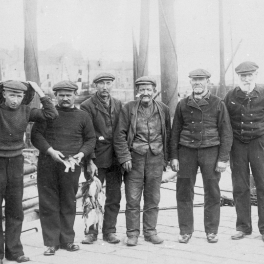 Six men, Pittenweem. Two of the men are holding flat fish. L-R: James Hughes, Thomas Hughes, Thomas Spense, James Dewar, William Horssburgh, and John Doig.