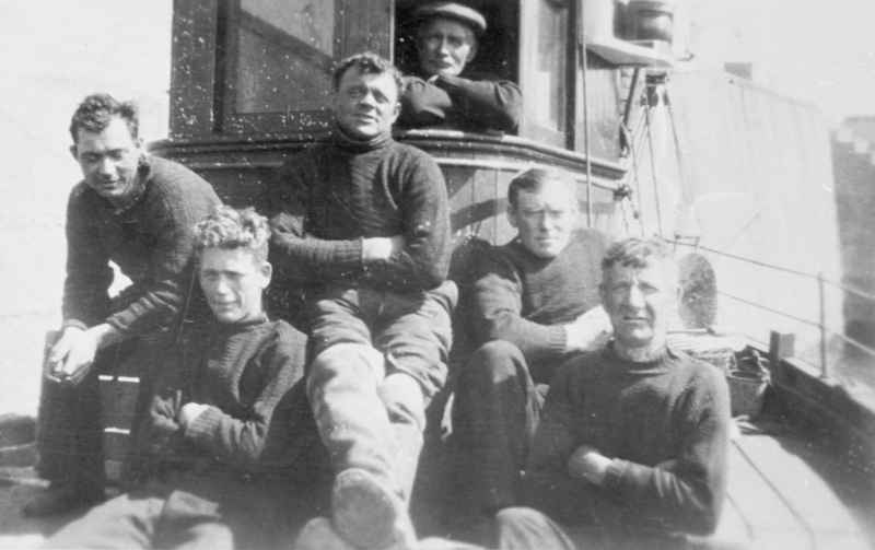 Crew of drifter, 'Just Reward', KY239. Skipper D. Costorphine is second right. It is believed that Thomas Anderson is pictured second from the left. He was lost at sea 1.5 miles from May Island when he is believed to have falled overboard. He was 27. Original - A. Anderson, Roger St, Cellardyke.