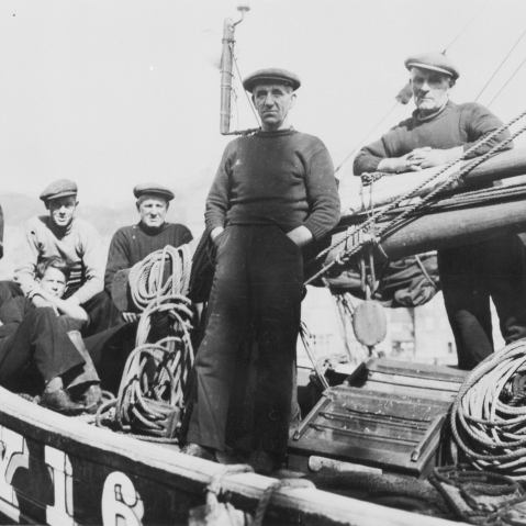 Crew onboard 'Good Hope', KY165, c. 1938. Seated men, top row, L-R: David Corstorphine, Patterson Wallace, Unknown. Seated men, bottom row, L-R: Bobby Duncan, Unknown. Standing men, L-R: George Gourlay, Billy Smith. Original image from E. Doig, Cellardyk